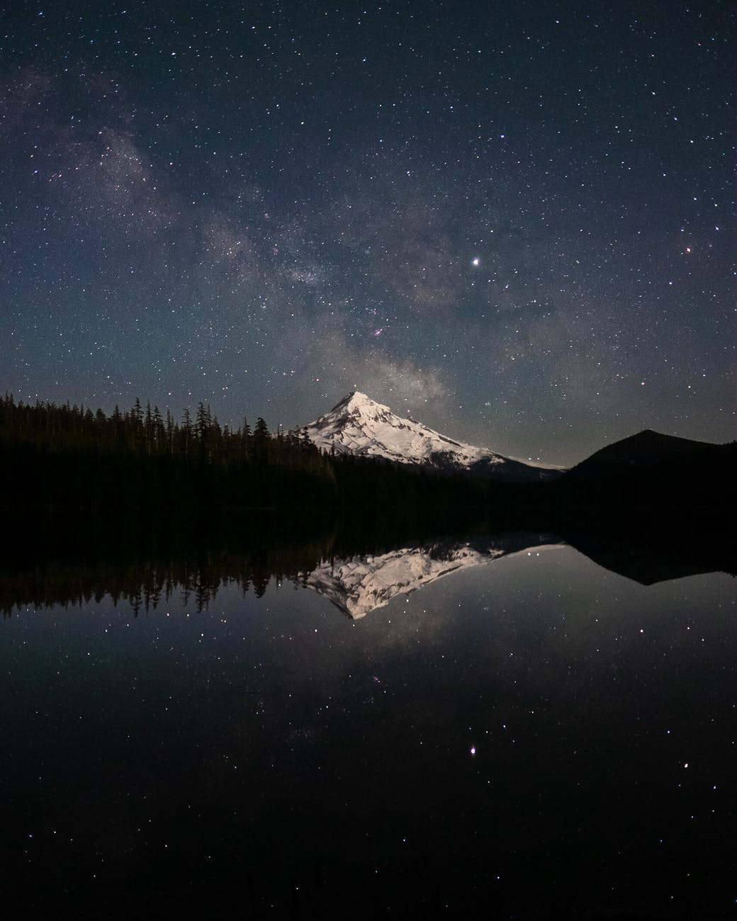 photography of a snowy mountain during nighttime